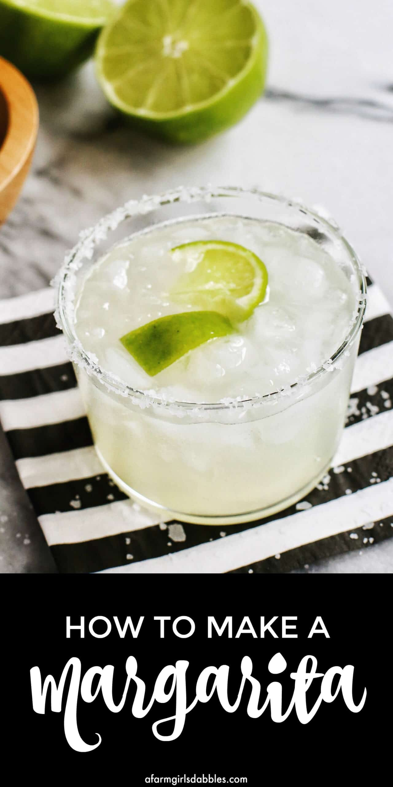 pinterest image of traditional margarita in a salt rimmed glass