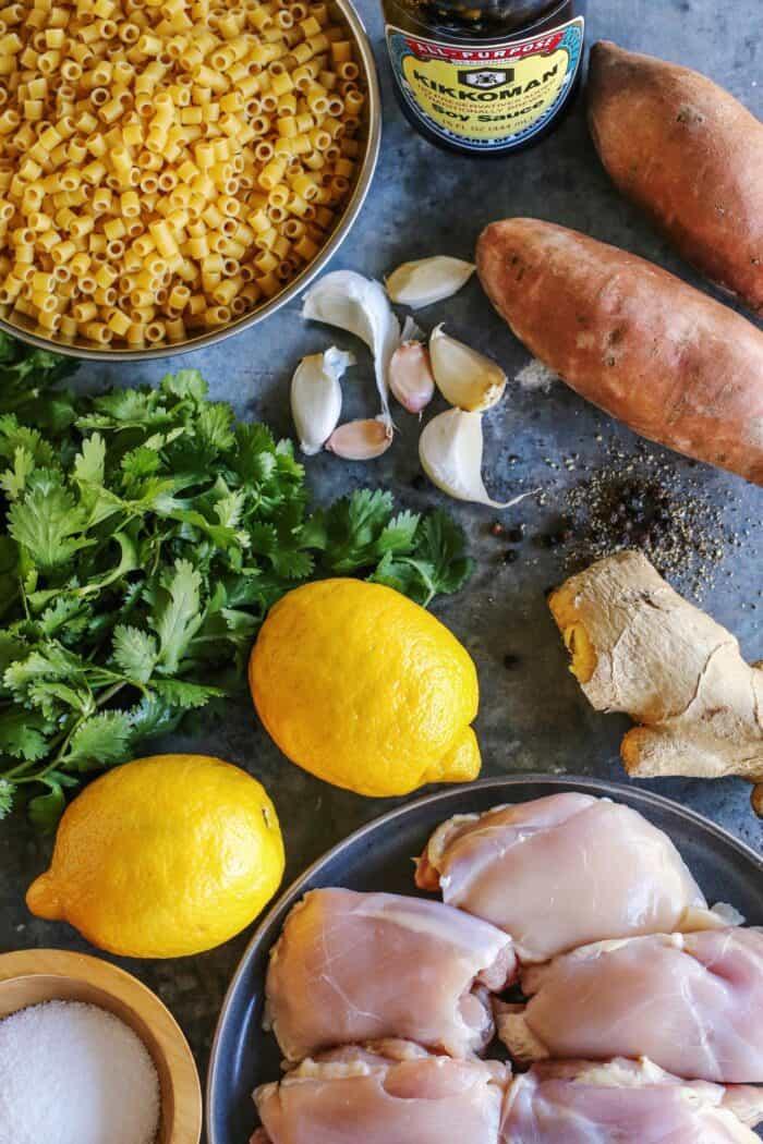 ingredients for ginger chicken soup: chicken thighs, pasta, sweet potatoes, ginger, garlic, lemon