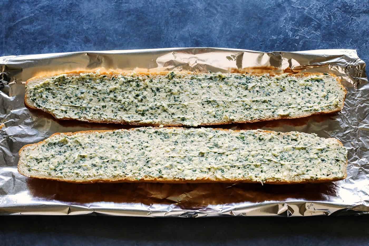 garlic bread spread on bread loaf halves