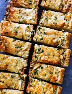 buttery, cheesy garlic bread cut into pieces
