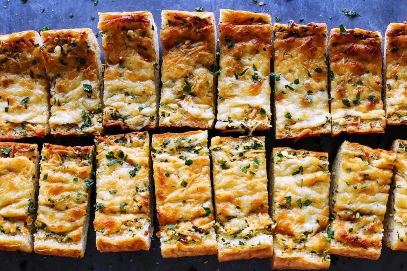 cheesy garlic bread cut into pieces
