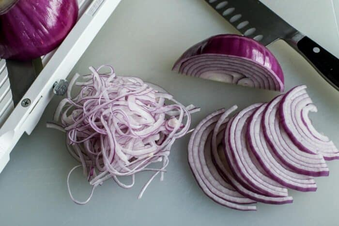 thinly sliced red onions