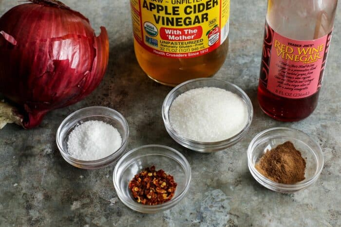 ingredients for pickled red onions - red onion, apple cider vinegar, red wine vinegar, salt, sugar, chili flakes, allspice