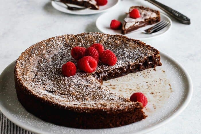 sticky chocolate cake with raspberries