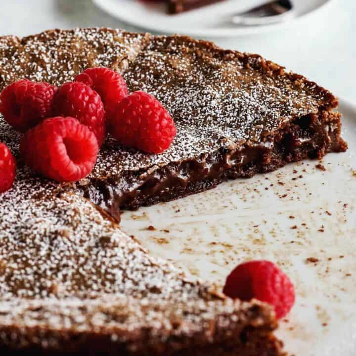 Swedish chocolate cake cut to reveal gooey, sticky interior.
