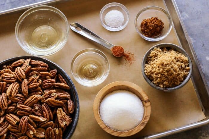 pecans, egg white, sugar, brown sugar, salt, cinnamon, cayenne pepper, vanilla extract