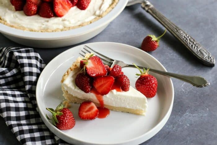 piece of strawberry cream cheese pie on a plate, with a fork