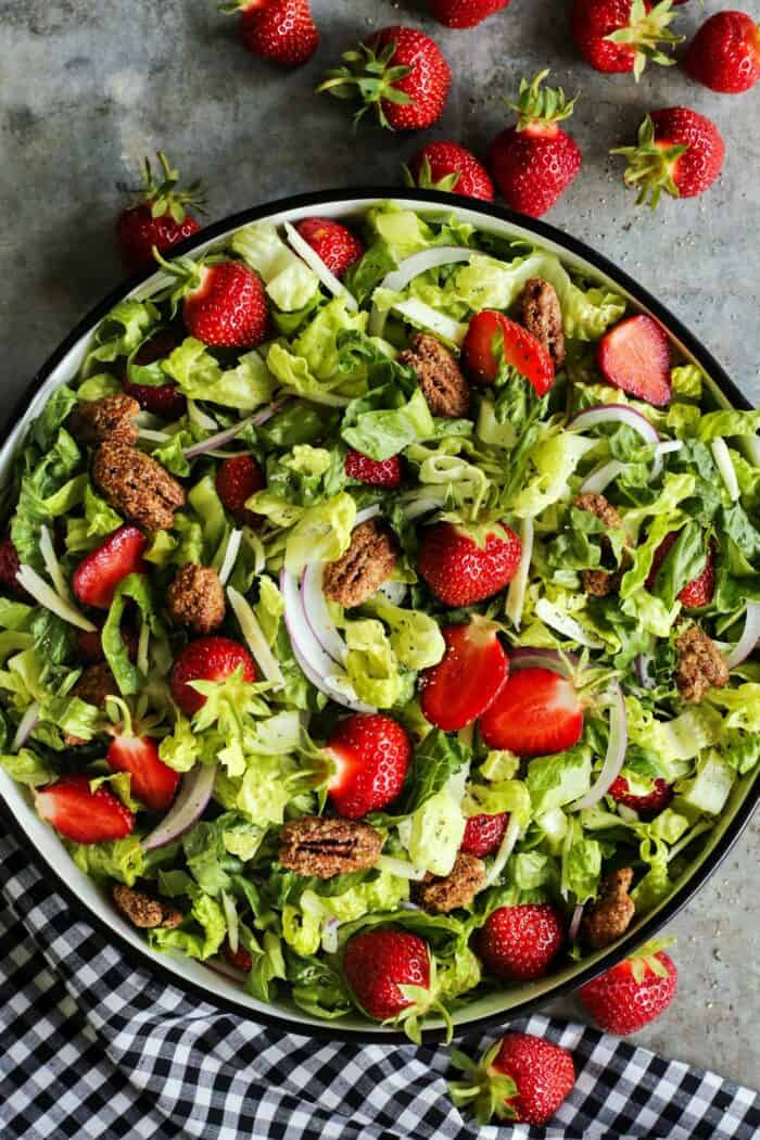 salad of fresh greens, strawberries, and candied pecans
