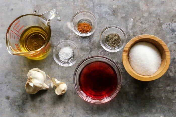 olive oil, garlic cloves, sugar, red wine vinegar, salt, pepper, and paprika