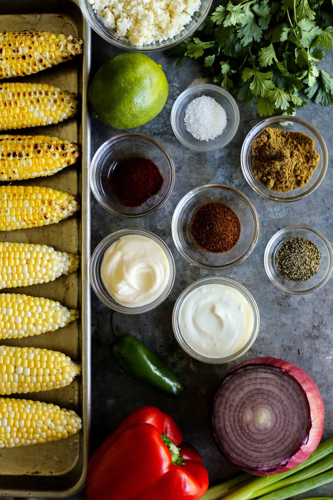 ingredients to make Mexican corn salad, all in separate containers