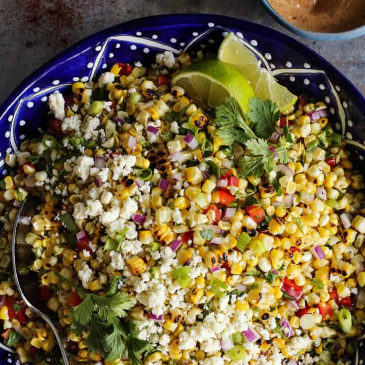 Mexican corn salad in a blue painted pottery bowl