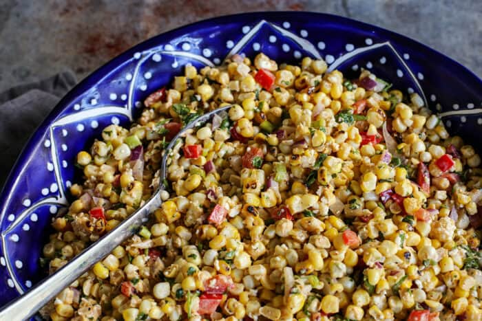 corn salad in a blue pottery bowl