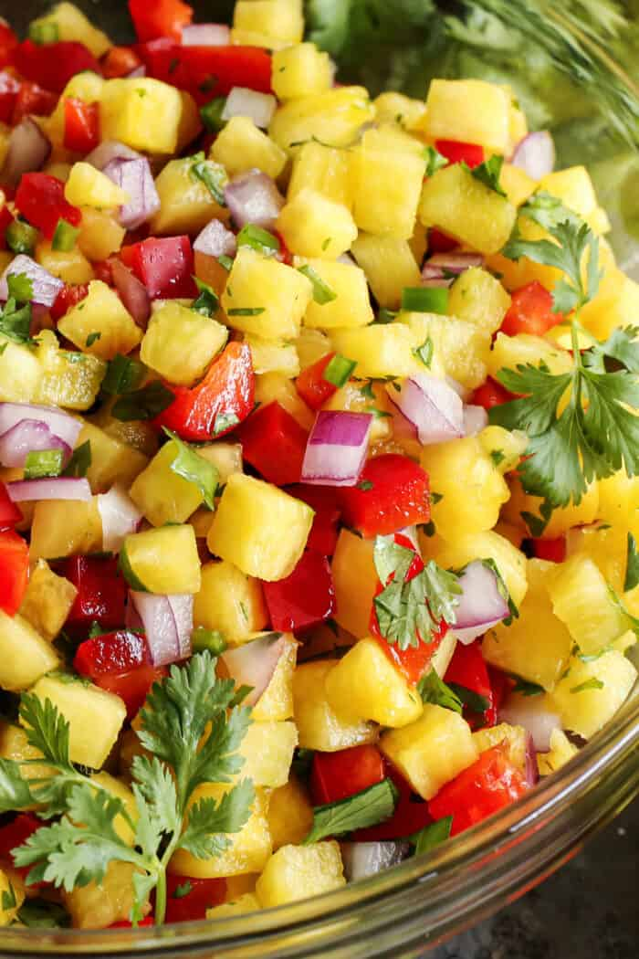 fresh salsa with pineapple, red bell pepper, red onion, and cilantro