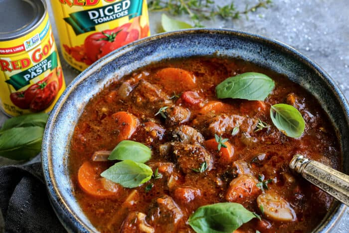 beef stew and cans of Red Gold diced tomatoes and tomato paste