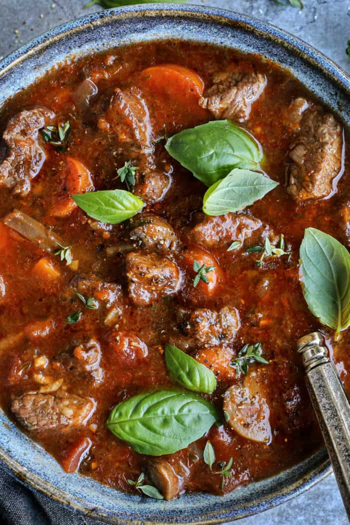 overhead close-up photo of Italian stew in a blue pottery bowl