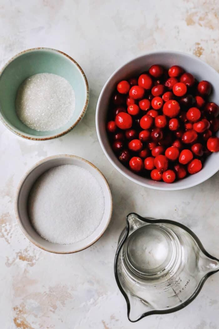 fresh cranberries, granulated sugar, sanding sugar, and water