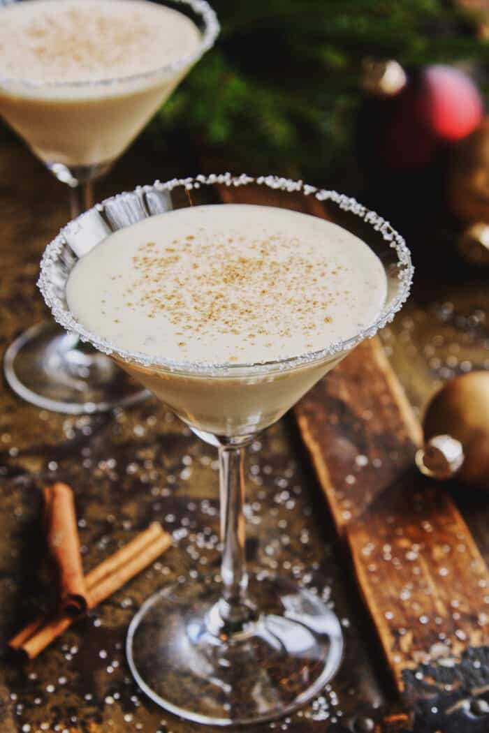 two glasses of eggnog cocktail in martini glasses