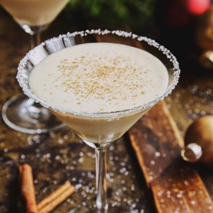 an eggnog drink in a martini glass