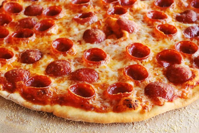 close-up of thin crust pizza with pepperoni and cheese