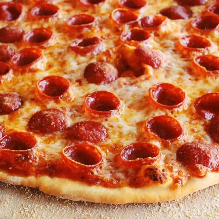 thin crust pizza dough crust on a pepperoni pizza