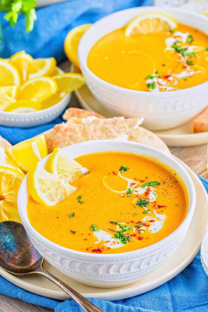 red lentil soup in white bowls