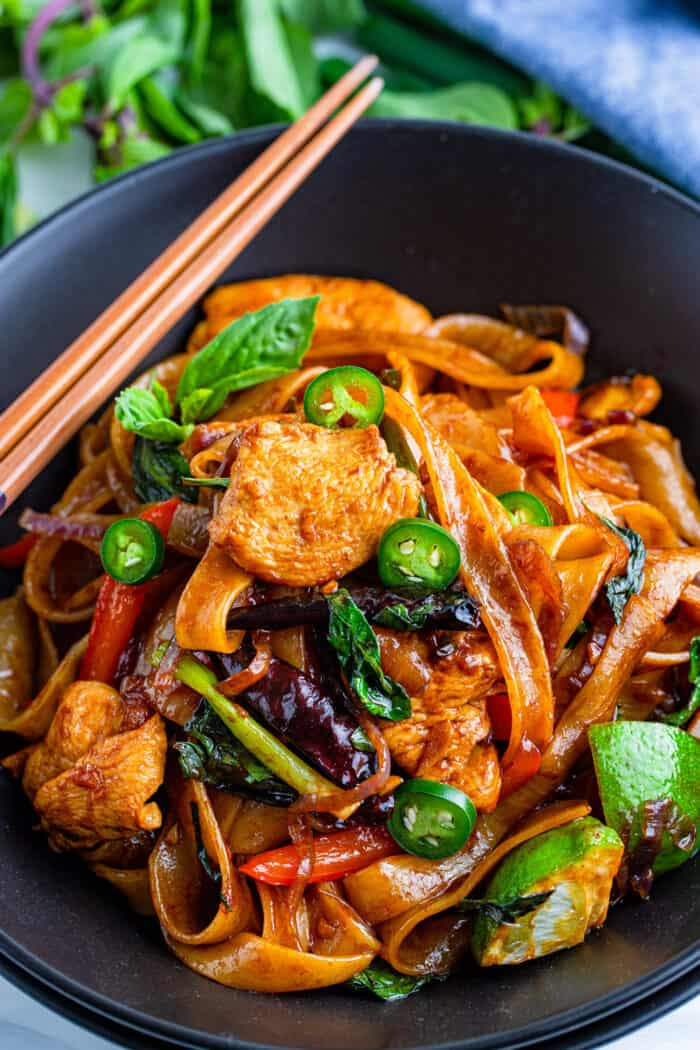 Thai rice noodle dish in a black bowl
