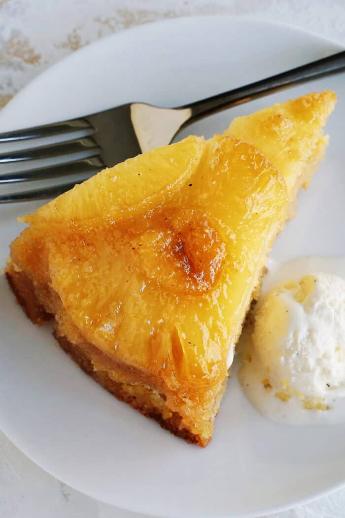 a slice of cake with pineapple