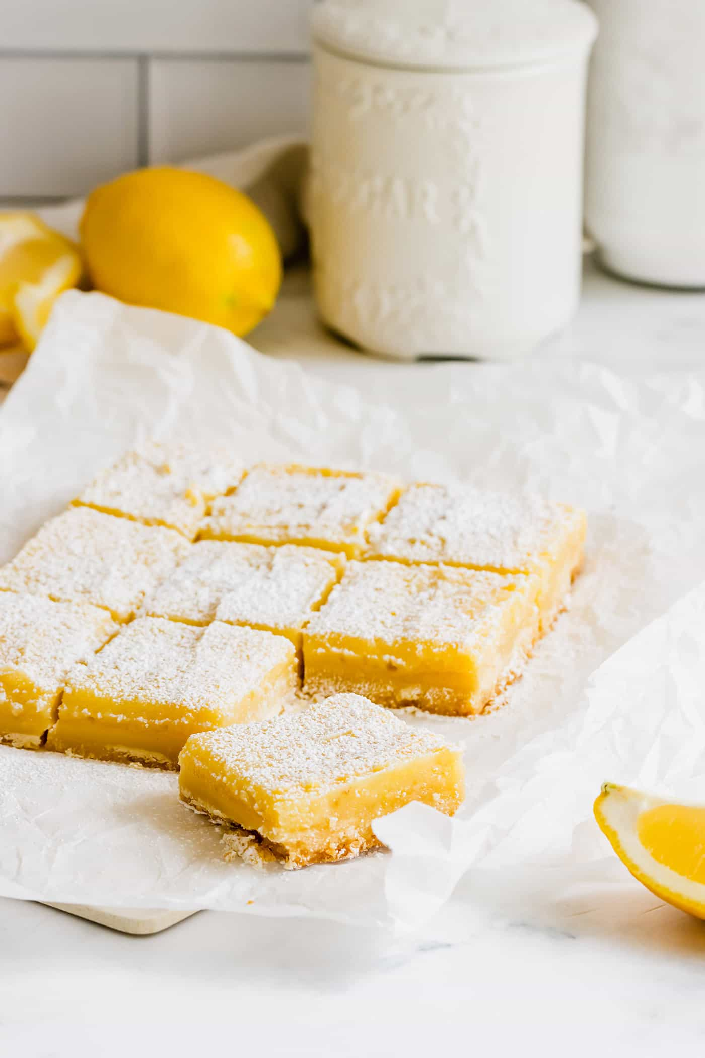 bars consisting of a shortbread crust topped with lemon curd and sprinkled with powdered sugar