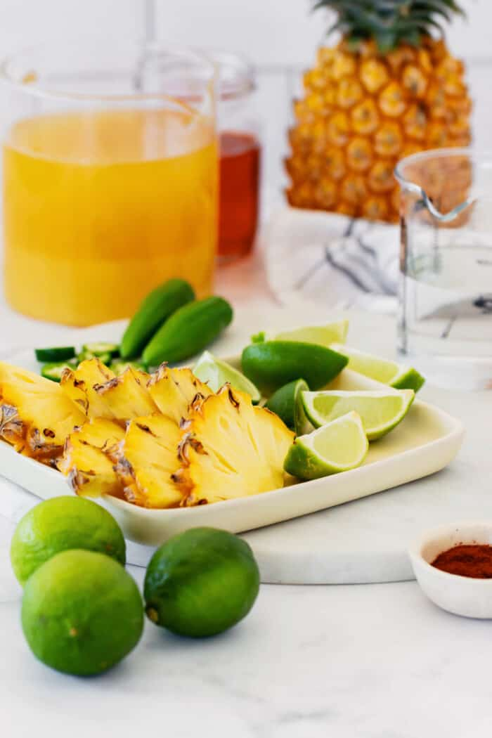 fresh pineapple, limes, and jalapeno, plus pineapple juice, tequila, and chili powder