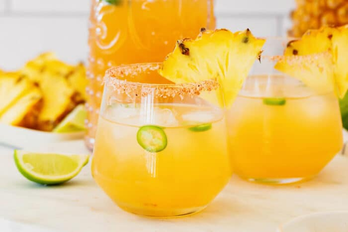 glasses of pineapple margaritas with jalapeno
