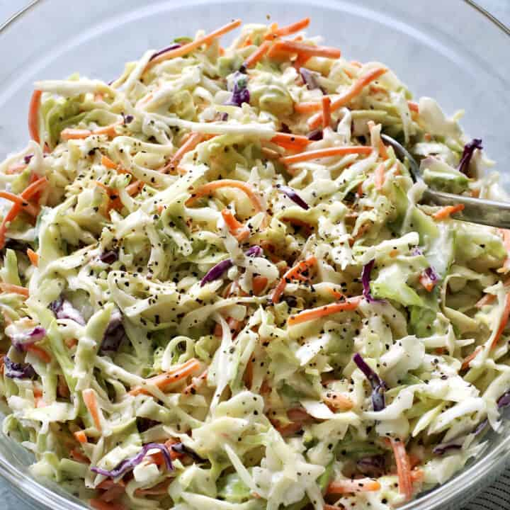 salad of shredded cabbage and carrots with a mayo and sour cream based dressing