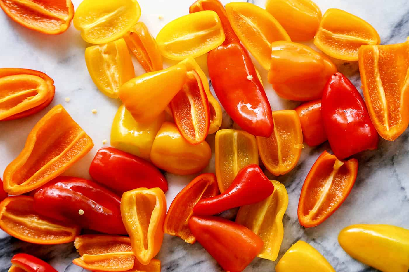 Halved mini sweet peppers in a pile