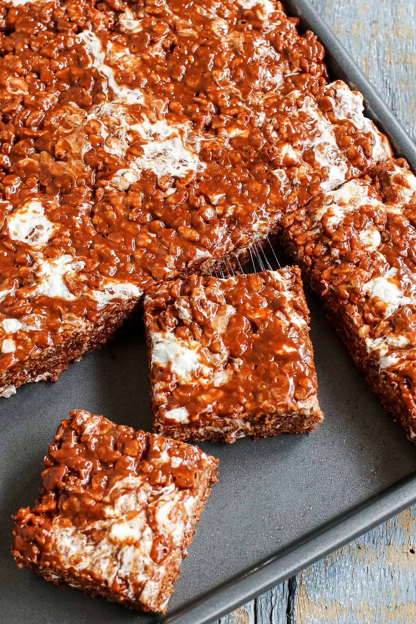 rice krispies bars with chocolate and extra marshmallow, in a baking pan