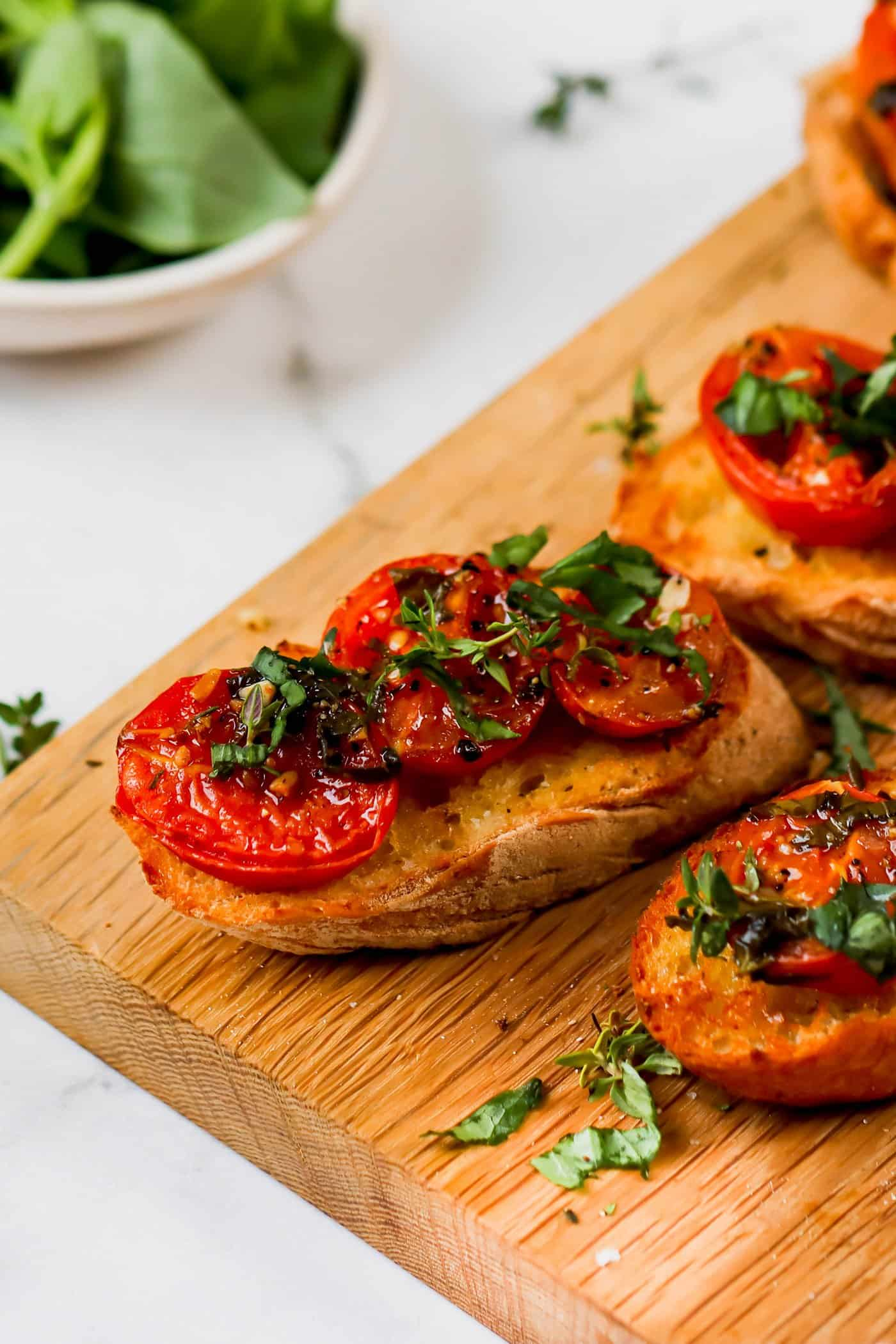 oven roasted tomatoes on toasted baguette slices