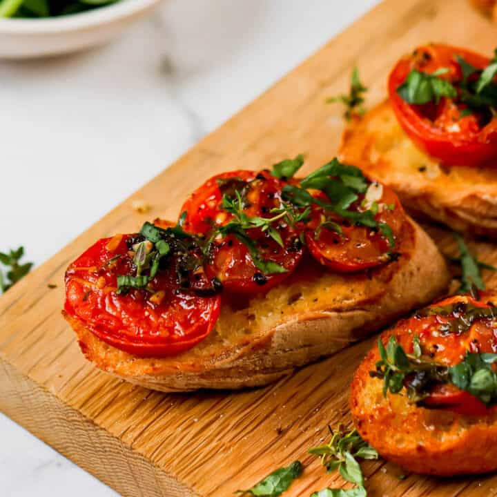 oven roasted tomato halves on slices of toasted baguette
