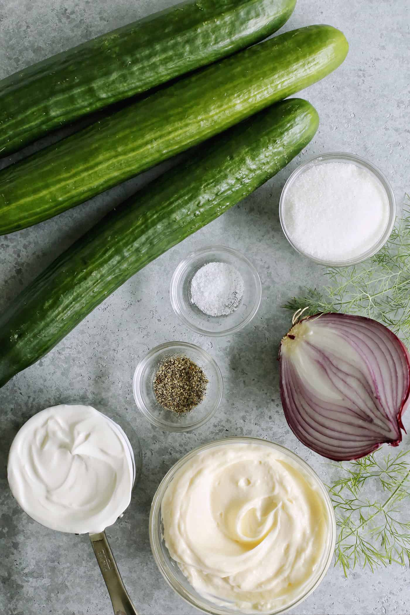 cucumbers, red onion, dill, mayonnaise, sour cream, sugar, salt, and pepper