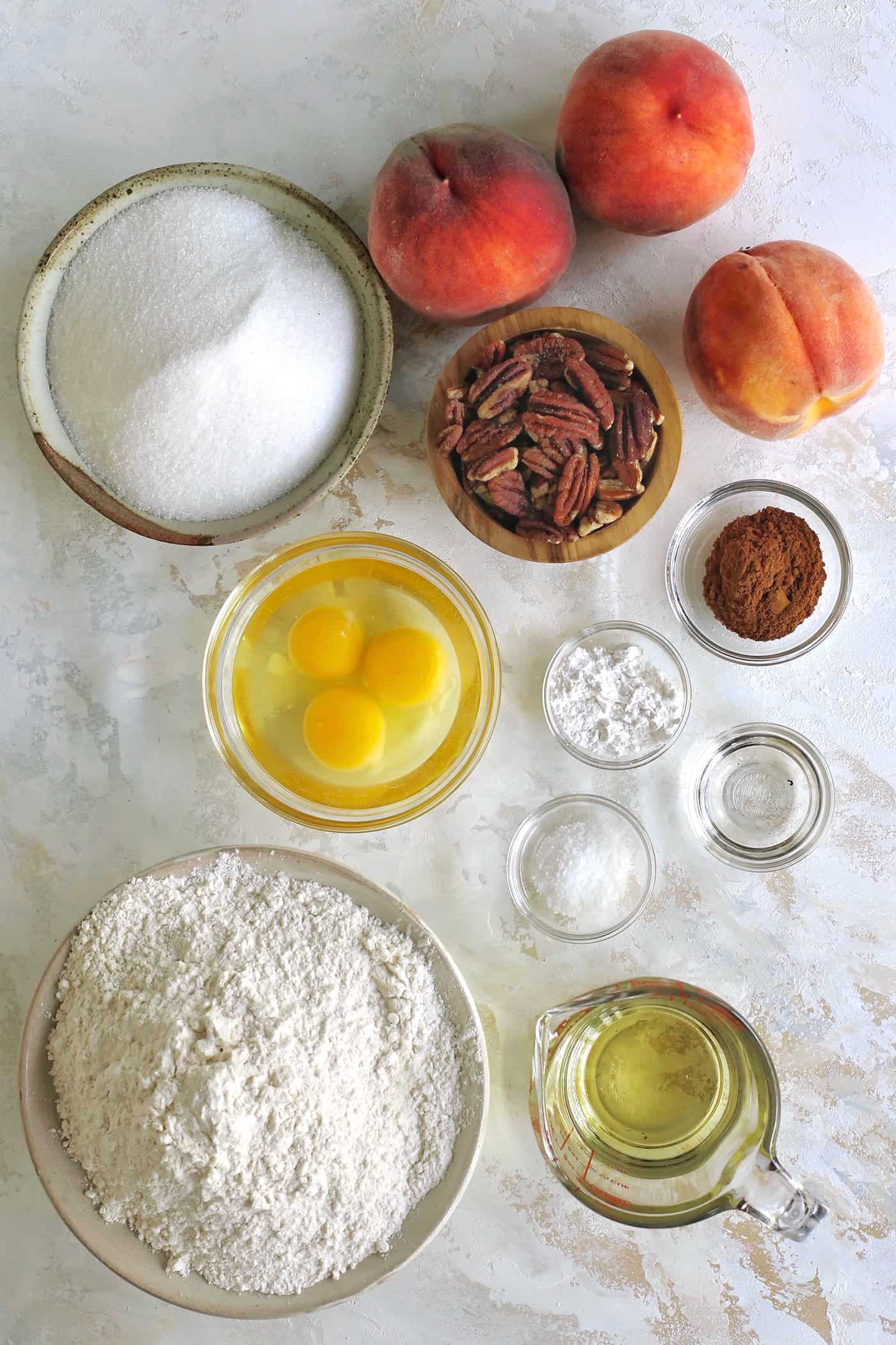 ingredients for peach bread, in separate bowls