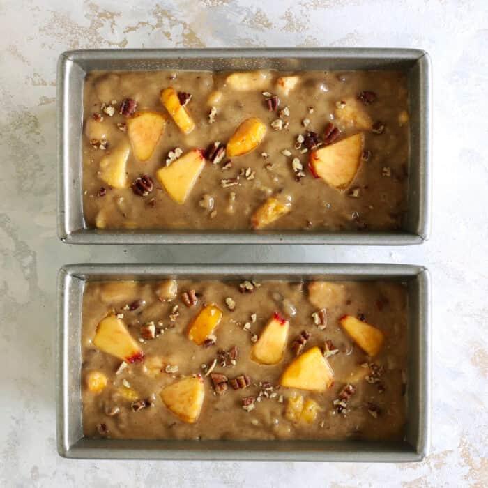 peach bread batter in two bread pans