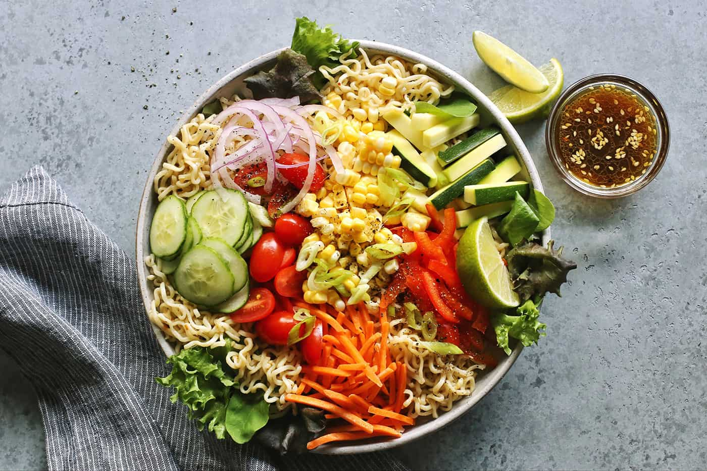a light gray bowl of salad ramen