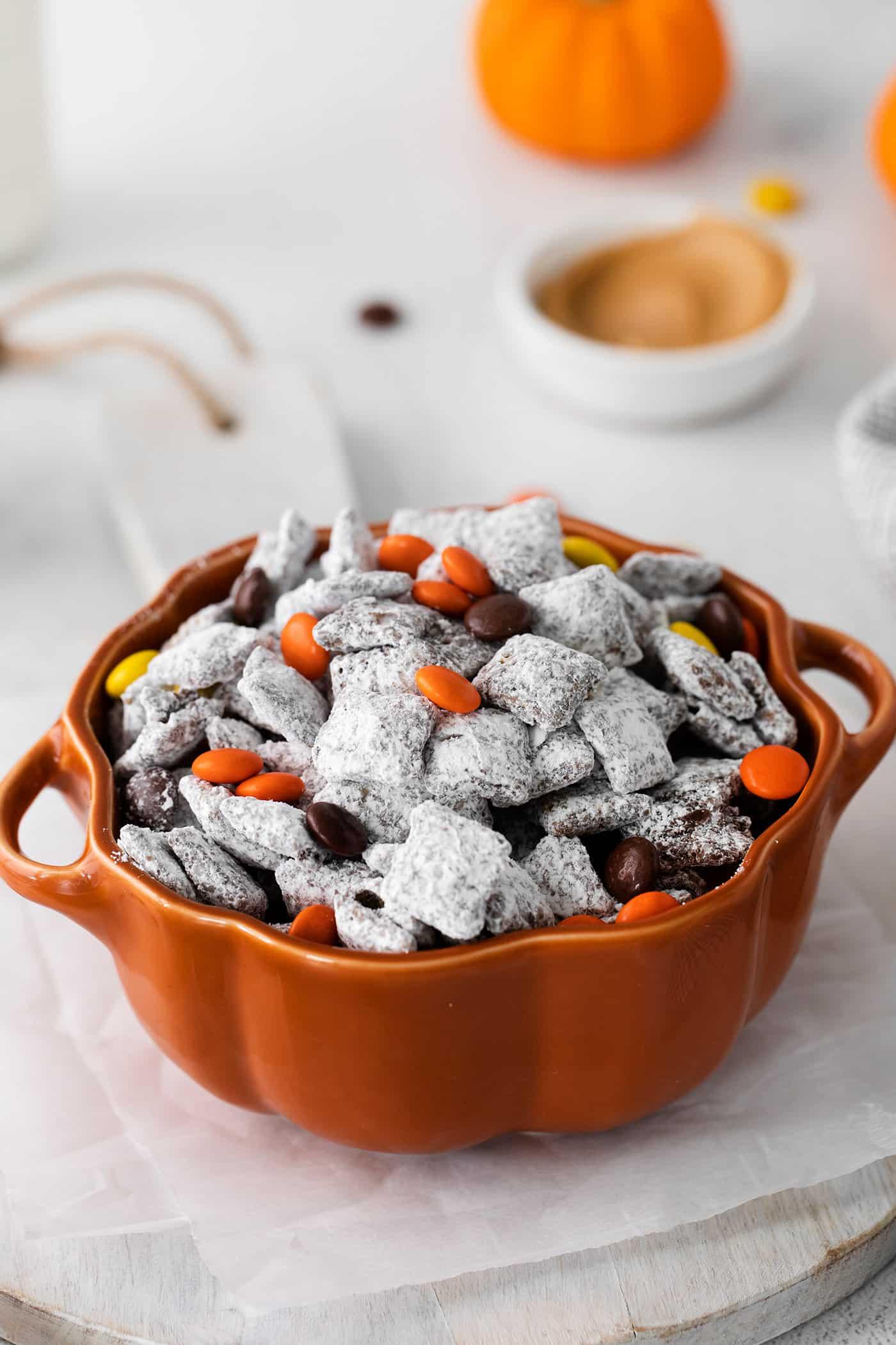 Puppy Chow (aka Muddy Buddies) for Halloween, in a pumpkin bowl