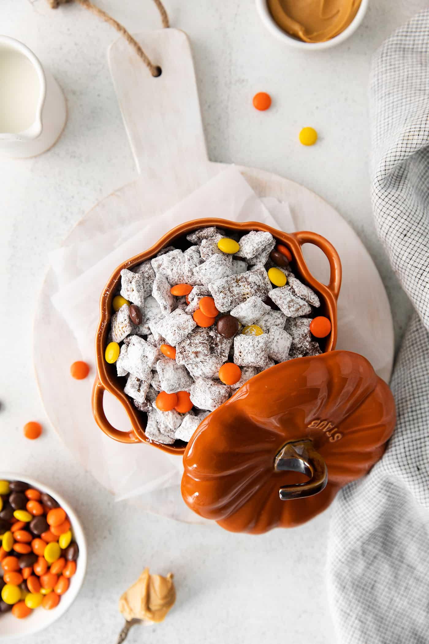 a pumpkin bowl full of Halloween Muddy Buddies